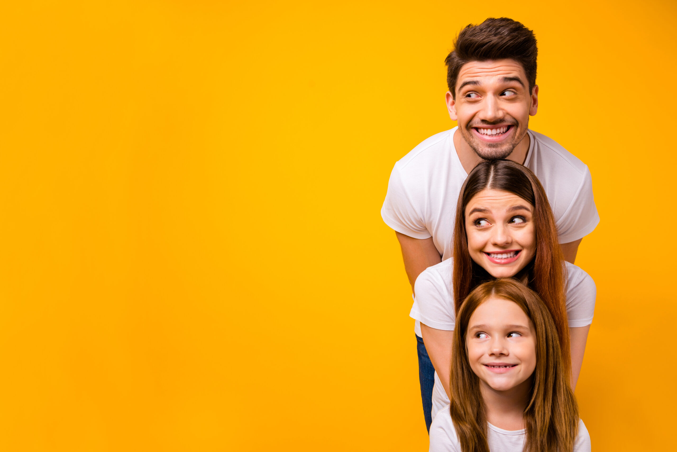 Portrait of three nice attractive charming lovely cute cheerful cheery person in order of hierarchy, duty looking aside copy space isolated over bright vivid shine yellow background