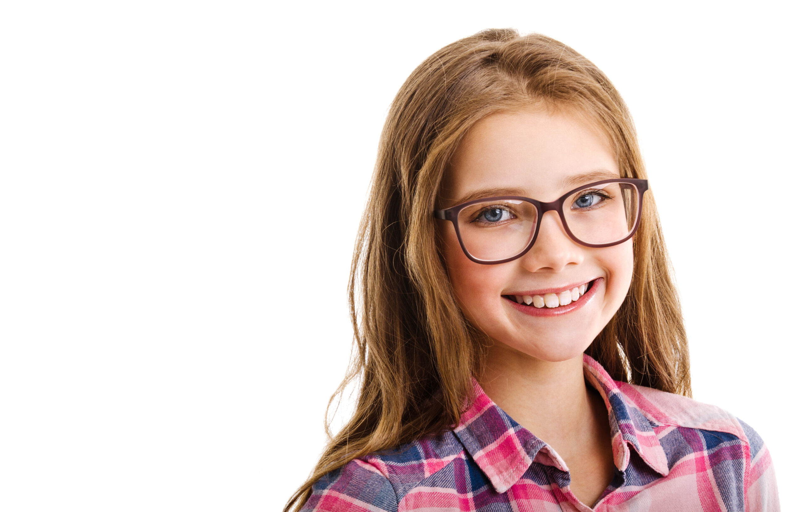 Smiling cute little girl child teen in eyeglasses education, school and vision concept isolated on a white